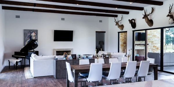 Contemporary farm ranch style home living room dining room exotic hunt animal game mount Bullard TX