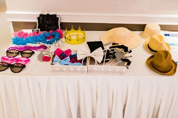 Lightfoot Premier Entertainment DJ's and Event Planning Theme Party props and accessories table