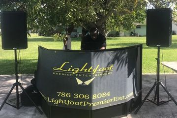 Small party setup two speakers outdoor with banner. Lightfoot Premier Entertainment DJ's and Event Planning