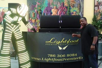 LED stilt robot with Lightfoot Premier Entertainment DJ's and Event Planning