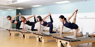 Pilates group classes in Beverly Hills, California. Strengthen your core. Improve your posture
