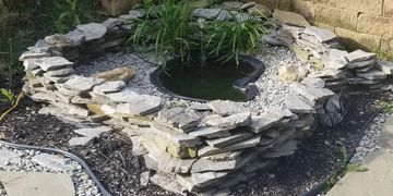 Outdoor pond done by The Aquarist Company