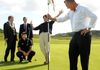 A whole in one from Minister with golf pros in Portrush