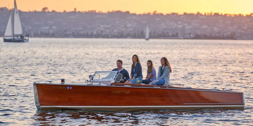 family photo boat photoshoot classic wood wooden vintage cris chris craft speedster runabout
