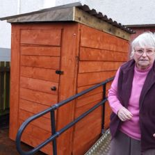 Dorothy with her new buggy shelter - it appears she is very pleased with it!