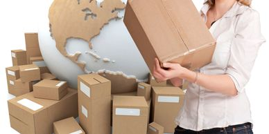 woman holding boxed orders to ship globally