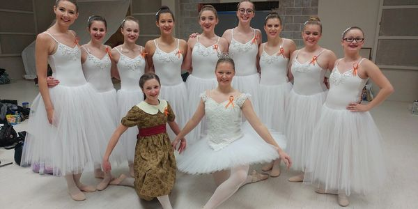 Snowflake dancers and Lucy from the dance production of The Lion, The Witch, and The Wardrobe.