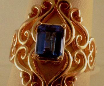 This is R-100s in 14 karat Gold our signature heavy filigree with an emerald cut sapphire