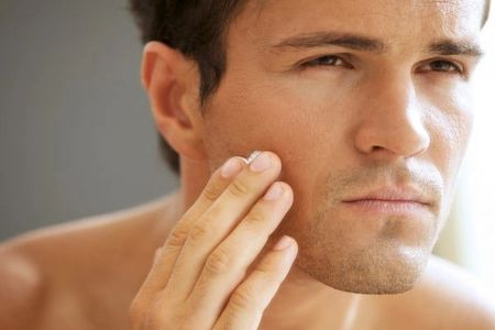 Male applying Pure Radiance Natural Skin Care Cream to face