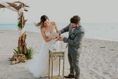 Sand Ceremony at a Sarasota Wedding with Driftwood Decor  DriftwoodWeddings.com