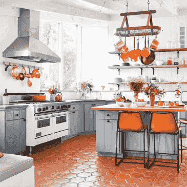Colorful kitchen, fun stools, multi-color cabinets, tile floors, all with a splash of fun paint