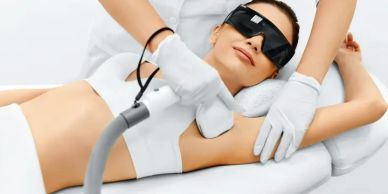 women gets a laser hair removal underarm