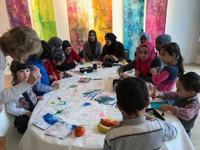 Newly arrived refugees in Vaxjo Sweden creating artworks at a public intervention.