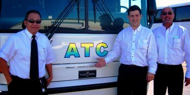 Avalos Transportation Company Inc, ATC Buses Orlando Team smiling for customers in front of ATC Bus