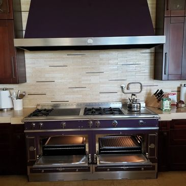 High end residential stove. 6 burners, 1 grill and 1 griddle.