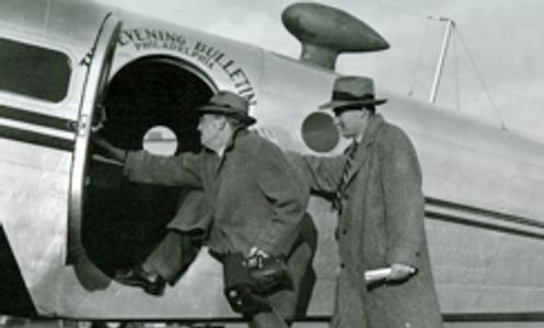 Bruce Murray Sr. & Jr. news and baseball photojournalist photographers in airplane