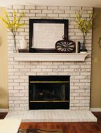 White Washed Fireplace painted fire place painted brick renovation updating fireplace Whtie mantel