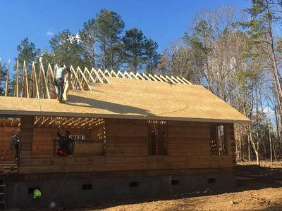 LOG HOME ROOF SYSTEM