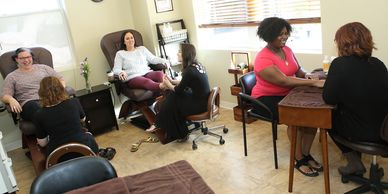 Nail room at East Village Spa, women getting pedicures and manicure