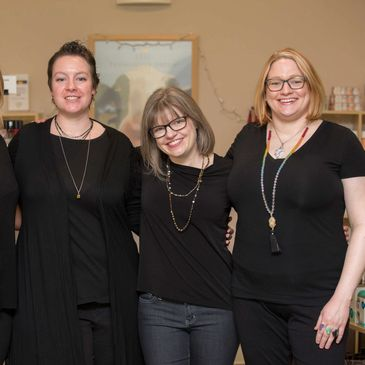 East Village Spa administration team. Left to right: Anne (she/her), Cassie (she/her) Spa Owner, Kel