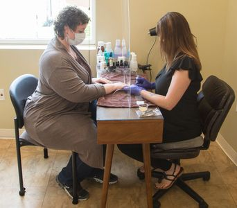 Safe Manicure at East Village Spa, Esthetician and customer both wearing masks and shield.