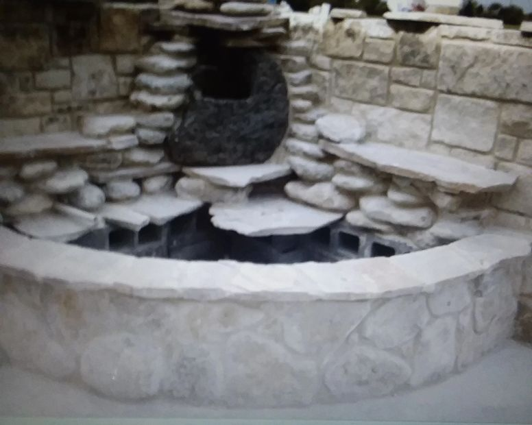 Construction of this pond is with a combination o variaty of stones and different materials.