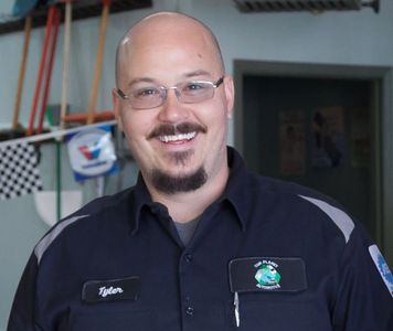 Tyler Dowling, Co-owner, ASE-certified Master Technician, with 20 years of automotive experience.