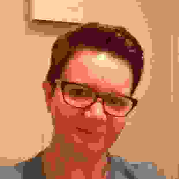 Image of Counsellor Shelley, she has short brown hair, glasses and looks friendly.