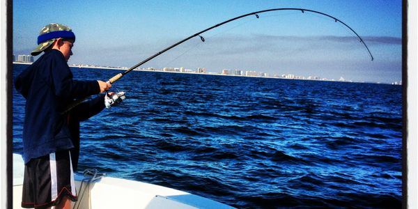 light tackle fishing for big redfish off the coast of Orange beach Alabama Kid friendly fishing