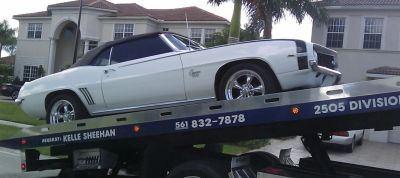 Flat bed towing service in west palm beach