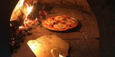 Homemade pizza in the wood-fired pizza oven at Tea Tree Hollow Canyonleigh Southern Highlands NSW