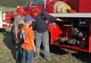 Future Lake George Fire Chief Tristan Weaver explaining the workings of a pump
