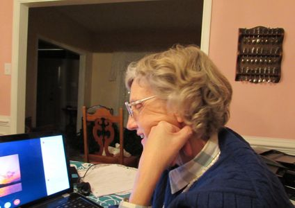 Carol McLaren works on a computer on someone's story.