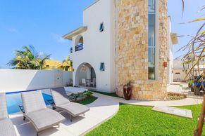 One Word: LUXURY! Located on Punta Sur, this gated 3 bedroom/3 bath piece of heaven is awaiting you!