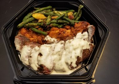 Beef with a Creamy Blue Cheese Sauce, Sweet Potato Hash and Mixed Vegetables.