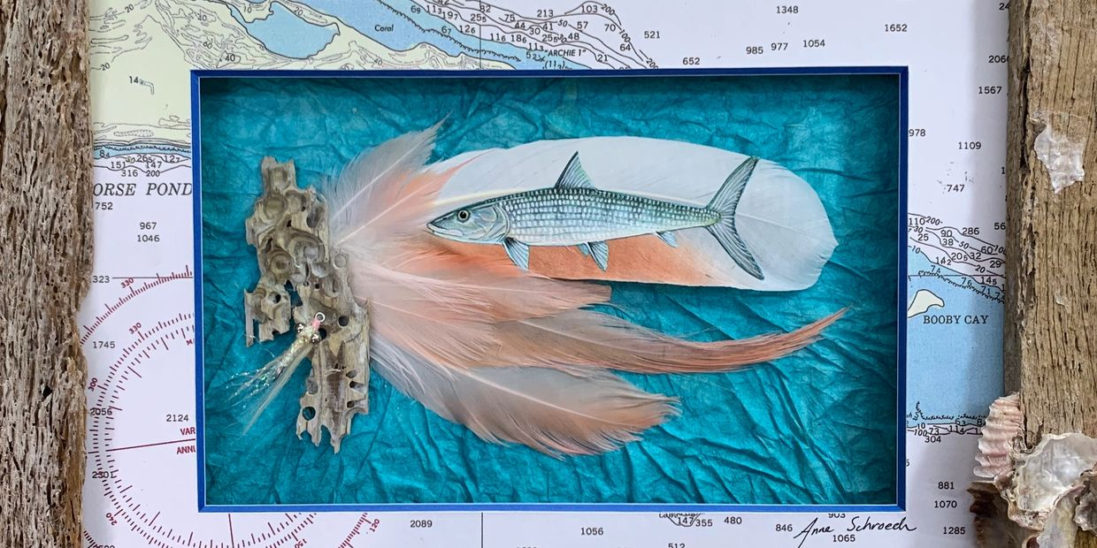 This is a bonefish I painted on feathers. Then I matted it with a chart of where my client fishes.