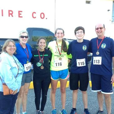 Dragon Run Race Founder and Nate's mom, Lauren Boerlin pictured with  President Coughlan and race pa
