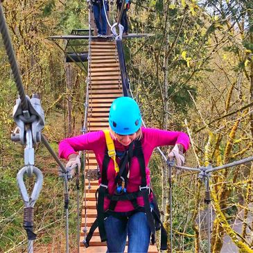 Adventurous woman taking on the 2nd suspension bridge on the tour.