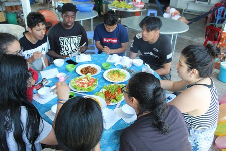 Students Discussing Nha Trang over Lunch