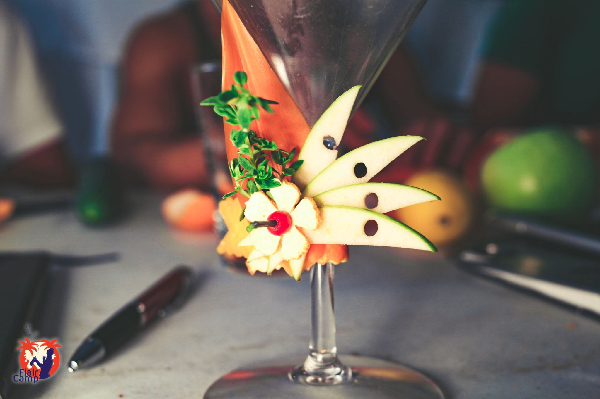fancy cocktail garnish with an apple fan .  We teach these kinds of garnishes at flair camp.