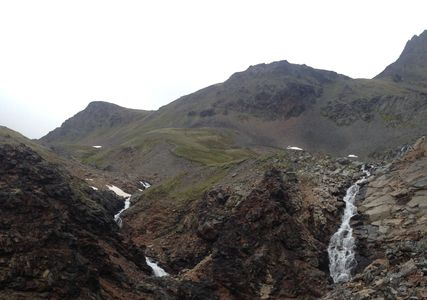 The water falls on the way to the summit of Crow Pass.