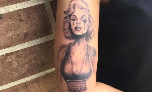 Marilyn Monroe black and white tattoo by Dre.