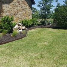 Lawn and landscaping.  Mulch and bed edging along with shrub trimming.