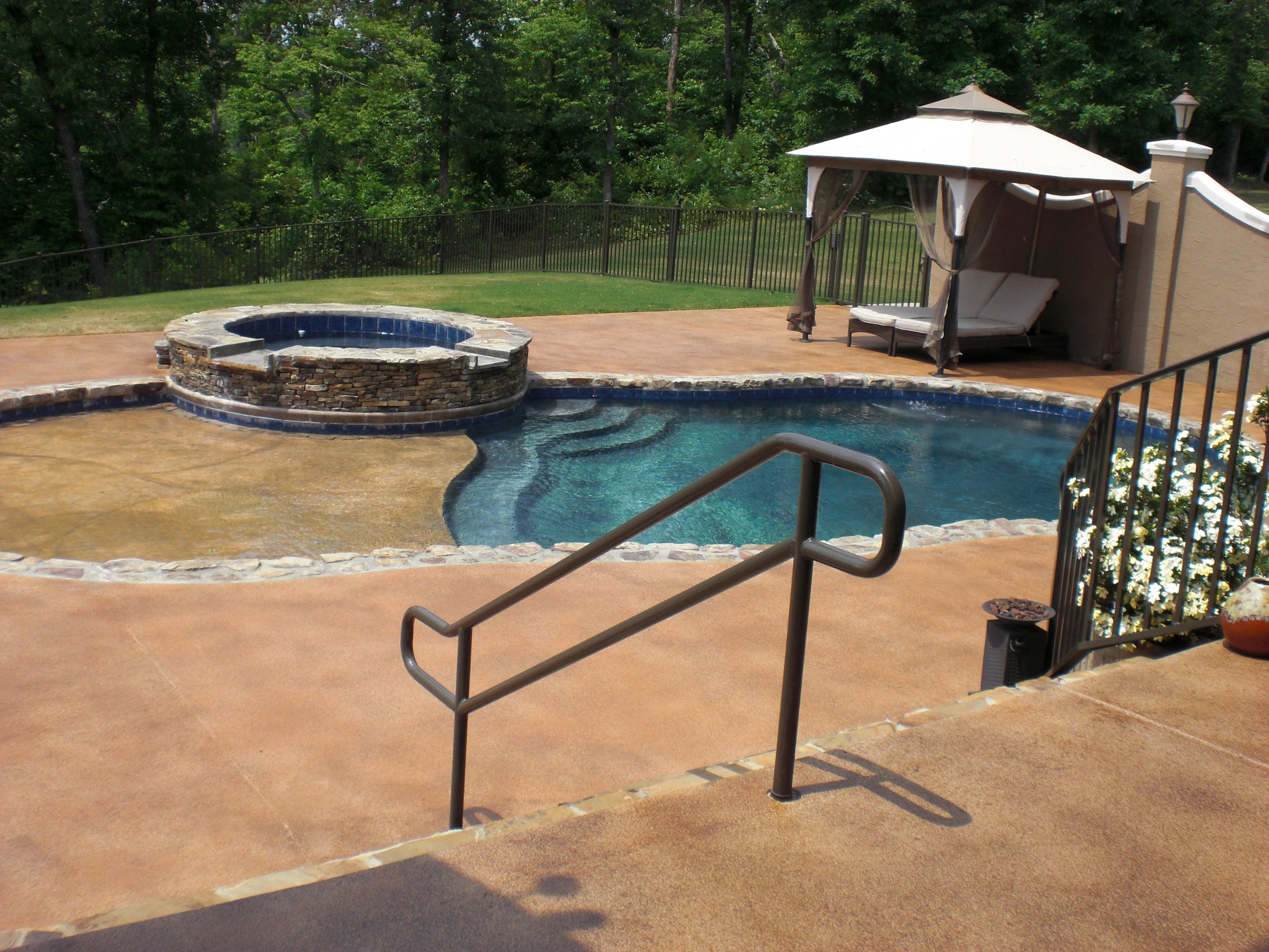 Pool Deck with distressed decorative concrete finish.