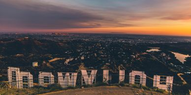 The Hollywood sign from behind with LA in the background.
