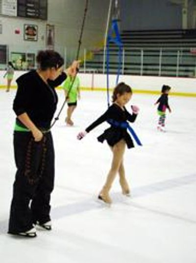 young figure skater using jump harness training system