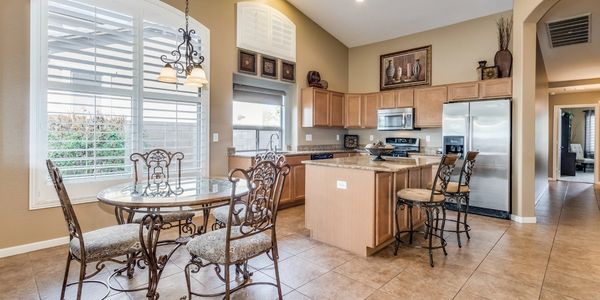 Open kitchen to family room, granite countertops, walk in pantry, stainless appliances