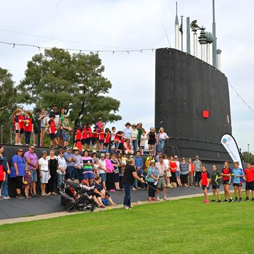A group photoshoot of the Healthy Towns challenge on the Submarine in Holbrook NSW