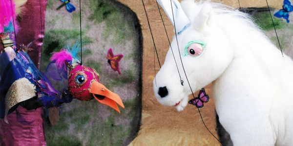 Unicorn and bird marionette puppet from In Search Of The Unicorn by Rosalita's Puppets
