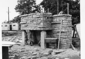 A Frank Lloyd Wright Usonian House hearth under construction by Don and Virginia Lovness, 1956